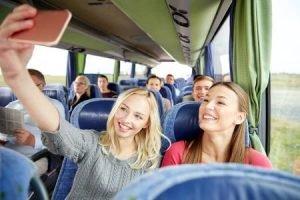 Girls having fun on a bus